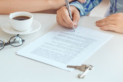 Young couple rent apartment together real estate. Young couple rent apartment together in the office signing contract Royalty Free Stock Photos