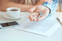 Young couple rent apartment together real estate. Young couple rent apartment together in the office signing contract Stock Photo