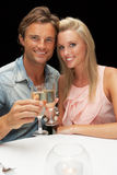 Young couple in restaurant Stock Photography