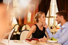 Young couple in a restaurant Stock Images