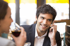 Young couple in restaurant breakfasted, man is on the phone Stock Photos