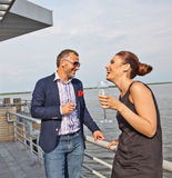 Young couple in restaurant. Young couple with champagne glasses in restaurant stock photo