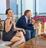 Young couple in restaurant. Young couple with champagne glasses in restaurant royalty free stock photo