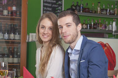 Young couple in restaurant environment Stock Image