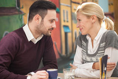 Young couple in restaurant Royalty Free Stock Photos