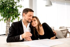 Young couple at the restaurant. Young loving couple embracing at the restaurant and waiting for the order Stock Images