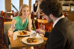 Young couple at a restaurant Stock Photos