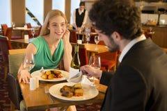 Young couple at a restaurant Stock Photos