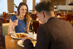 Young couple at a restaurant Stock Images