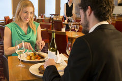 Young couple at a restaurant Royalty Free Stock Photos