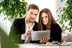 Young couple at the restaurant Stock Photos