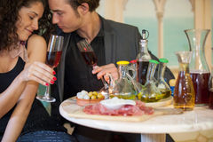 Young couple in restaurant Stock Images