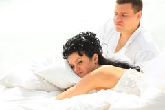 Young couple resting in bed Royalty Free Stock Photography