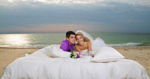 Young couple resting in bed Stock Images