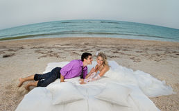Young couple resting in bed stock photography