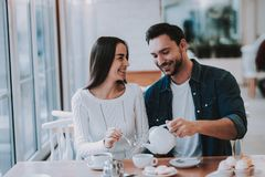 Young Couple is Resting in Cafe stock photos