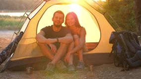 Smiling couple in a tent stock video