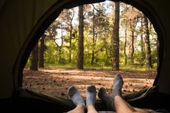 Young couple resting in camping tent royalty free stock images