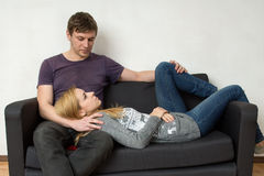 A young couple resting on the couch Royalty Free Stock Photography