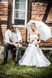 Young couple resting in front of vintage house royalty free stock image