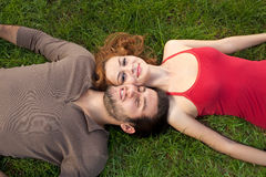 Young couple resting on the grass Stock Photos