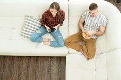 Young Couple Resting at Home royalty free stock photography
