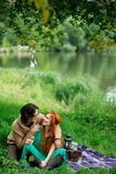 Young couple resting at the nature outdoors Royalty Free Stock Photo