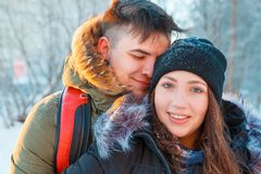 Young couple resting in park. Embrace and smilling of loving Royalty Free Stock Image