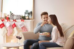 Young couple resting in room at Christmas. Time Stock Photos
