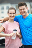 Young Couple Resting During Run In City royalty free stock images