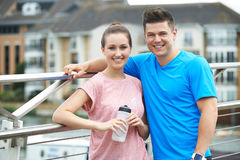 Young Couple Resting During Run In City stock photography
