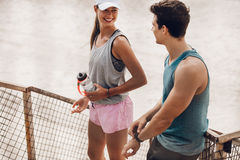 Young couple resting after running workout Stock Photos