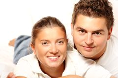 Young couple resting on a sofa Stock Image