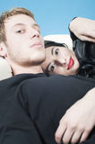 Young couple resting on a sofa Royalty Free Stock Photography
