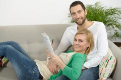 Young couple resting in the sofa Stock Images