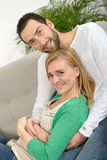 Young couple resting in the sofa Royalty Free Stock Photography