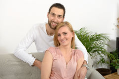 Young couple resting in the sofa Stock Image