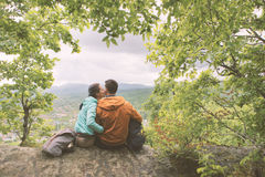 Young couple resting on top the mountain. Royalty Free Stock Photo