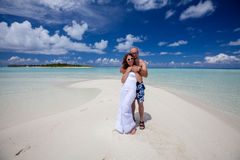 Young couple rests at the beach of Maldivian island Stock Photography
