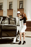Young couple with a retro car. Royalty Free Stock Photography