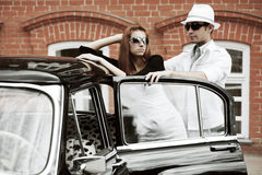 Young couple with a retro car Royalty Free Stock Photo