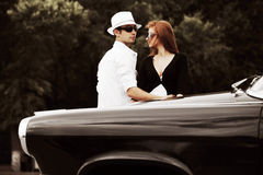 Young couple with a retro car Stock Photo
