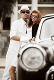 Young fashion couple in love by retro car. Happy young fashion couple in love by retro car Royalty Free Stock Images