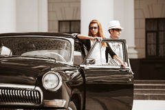 Young couple with a retro car Stock Image