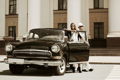 Young fashion couple at the retro car Royalty Free Stock Images