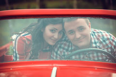 Young couple in a retro car Stock Photo