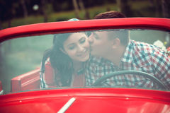 Young couple in a retro car Royalty Free Stock Photos