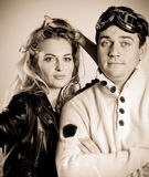 Young couple in retro style clothes. Sepia portrait Royalty Free Stock Images