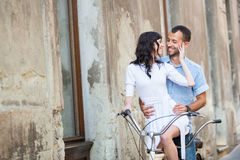 Young couple on retro tandem bicycle at the street city Stock Image