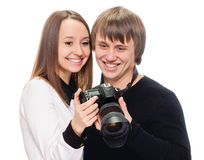 Young couple reviewing good shot Royalty Free Stock Image